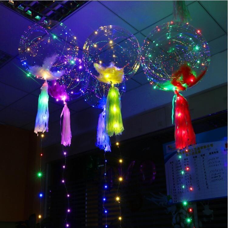 Позрачные шары с перьями и светодиодами